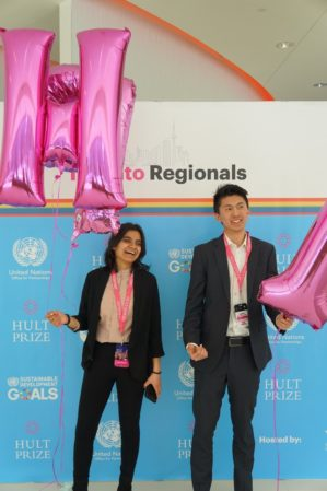 Photo of Adya Aggarwal and Eric Li holding balloons at the Hult Prize competition in Toronto